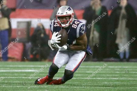 Stock Photo of New England Patriots tight end Benjamin Watson catches a pass in the second half of an NFL wild-card playoff football game against the Tennessee Titans, in Foxborough, Mass