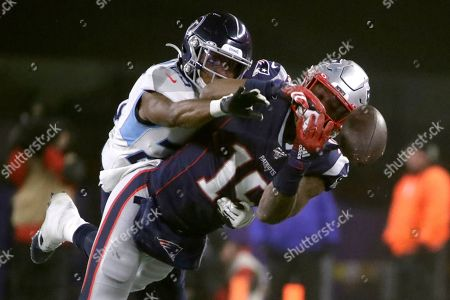 Tennessee Titans cornerback Adoree' Jackson, left, breaks up a pass intended for New England Patriots wide receiver N'Keal Harry in the second half of an NFL wild-card playoff football game, in Foxborough, Mass