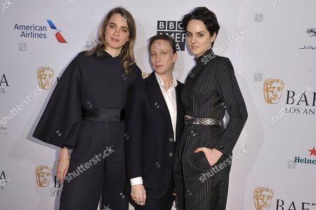 Adele Haenel, Celine Sciamma, Noemie Merlant. Adele Haenel, from left, Celine Sciamma and Noemie Merlant attend the 2020 BAFTA tea party at the Four Seasons Hotel, in Los Angeles