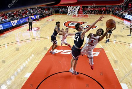 Western Kentucky Hilltoppers guard Jordan Rawls (3) lays the ball in over the arm of Rice Owls guard Drew Peterson (23) during a NCAA basketball game between the Rice Owls and the WKU Hilltoppers at E.A. Diddle Arena in Bowling Green, KY (Photo Credit: Steve Roberts.CSM)