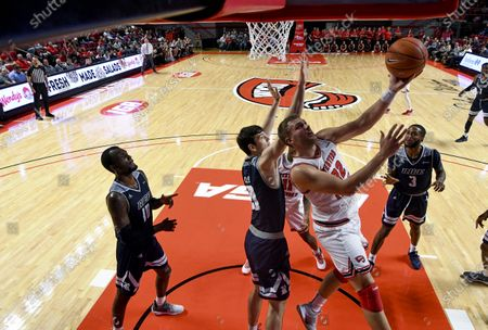 Western Kentucky Hilltoppers forward Carson Williams (22) does a reverse lay up over Rice Owls forward Zach Crisler (20) during a NCAA basketball game between the Rice Owls and the WKU Hilltoppers at E.A. Diddle Arena in Bowling Green, KY (Photo Credit: Steve Roberts.CSM)