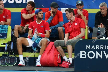 Russsia's Karen Khachanov sits on the bench during a point break as he is encouraged by Russian Captain Marat Safin, right, in his match against Taylor Fritz of the United States during their match at the ATP Cup in Perth, Australia