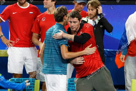 Russsia's Daniil Medvedev, left, is hugged by Russian Captain Marat Safin after defeating John Isner of the United State in their match at the ATP Cup in Perth, Australia