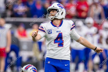 Buffalo Bills kicker Stephen Hauschka (4) kicks an extra point during the 1st quarter of an NFL football playoff game between the Buffalo Bills and the Houston Texans at NRG Stadium in Houston, TX. The Texans won 22 to 19 in overtime