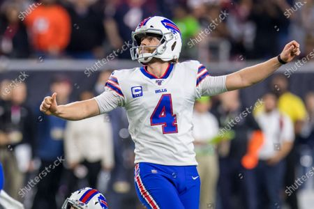 Buffalo Bills kicker Stephen Hauschka (4) watches his field goal that tied the game late in the 4th quarter of an NFL football playoff game between the Buffalo Bills and the Houston Texans at NRG Stadium in Houston, TX. The Texans won 22 to 19 in overtime