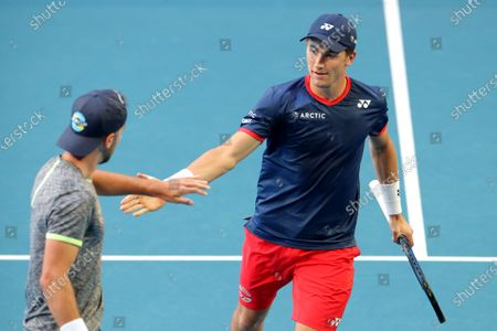 Casper Ruud and Viktor Durasovic of Norway in action during their doubles match against Fabio Fognini and Simone Bolelli of Italy during day three of the ATP Cup tennis tournament at RAC Arena in Perth, Australia, 05 January 2020.