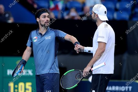 Fabio Fognini and Simone Bolelli of Italy in action during their doubles match against Casper Ruud and Viktor Durasovic of Norway during day 3 of the ATP Cup tennis tournament at RAC Arena in Perth, Australia, 05 January 2020.