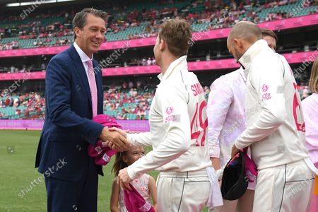 Steve Smith and Nathan Lyon of Australia present their pink caps to Glenn McGrath during day three of the third Test Match between Australia and New Zealand at the Sydney Cricket Ground (SCG) in Sydney, Australia, 05 January 2020.