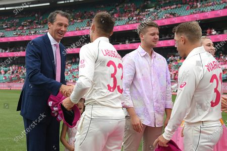 Stock Picture of Marnus Labuschagne and David Warner of Australia present their pink caps to Glenn McGrath during day three of the third Test Match between Australia and New Zealand at the Sydney Cricket Ground (SCG) in Sydney, Australia, 05 January 2020.