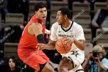 Vanderbilt guard Jordan Wright, right, drives against SMU forward Everett Ray, left, in the first half of an NCAA college basketball game, in Nashville, Tenn