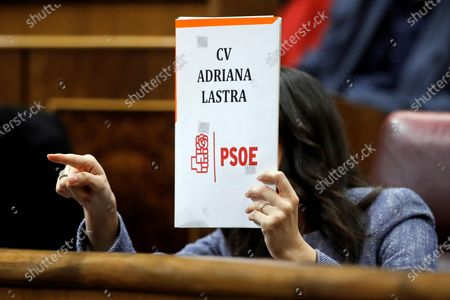 Spanish opposite Ciudadanos (Citizens) party's parliamentary spokeswoman Ines Arrimadas Garcia displays a fake curriculum vitae of Socialist Party's Parliamentary spokeswoman, Adriana Lastra (unseen), as Lastra delivers a speech during the second session of Prime Minister designate Pedro Sanchez's investiture debate at Lower Chamber of Spanish Parliament, in Madrid, Spain, 05 January 2020. Acting Prime Minister Pedro Sanchez faces his investiture debate for 14th legislative period after reaching an agreement with Catalan pro-independent party ERC and other minor parties. The Chamber will vote the investiture of Sanchez later today and if he does not obtain an absolute majority the vote will be repeated next 07 January when he only needs a simple majority.