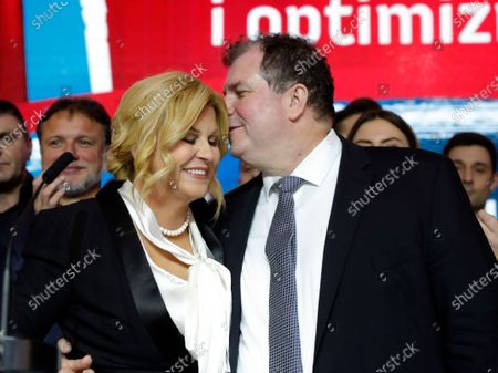 Croatian Presidential candidate and current President Kolinda Grabar-Kitarovic (L) and her husband Jakov Kitarovic (R) speak to supporters after the Presidential elections in Zagreb, Croatia, 05 January 2020. According to initial exit polls, Zoran Milanovic has won presidential elections with 54 percent of votes ahead of incumbent president Kolinda Grabar-Kitarovic.