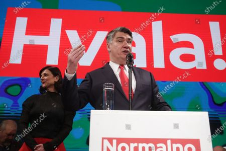 Croatian presidential candidate of Social Democratic Party (SDP) Zoran Milanovic (R) speaks to supporters as his wife Sanja Pusic (L) looks on during an election night rally in Zagreb, Croatia, 05 January 2020. According to initial exit polls, milanovic has won presidential elections with 54 percent of votes ahead of incumbent president Kolinda Grabar-Kitarovic.