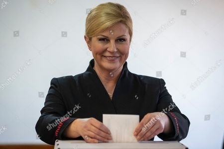 Incumbent president Kolinda Grabar-Kitarovic casts her ballot at a polling station in Zagreb, Croatia,. Voters in Croatia on Sunday cast ballots to choose a new president in a fiercely contested runoff race, with a liberal opposition candidate posing a challenge to the conservative incumbent as the country presides the European Union during a crucial period