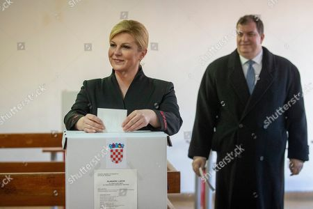 Incumbent president Kolinda Grabar-Kitarovic casts her ballot at a polling station in Zagreb, Croatia, Sunday, Jan.5, 2020. Voters in Croatia on Sunday cast ballots to choose a new president in a fiercely contested runoff race, with a liberal opposition candidate posing a challenge to the conservative incumbent as the country presides the European Union during a crucial period