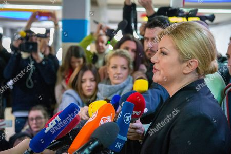 Incumbent president Kolinda Grabar-Kitarovic addresses the media after voting at a polling station in Zagreb, Croatia, Sunday, Jan.5, 2020. Voters in Croatia on Sunday cast ballots to choose a new president in a fiercely contested runoff race, with a liberal opposition candidate posing a challenge to the conservative incumbent as the country presides the European Union during a crucial period