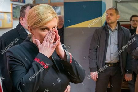 Incumbent president Kolinda Grabar-Kitarovic leaves after voting at a polling station in Zagreb, Croatia, Sunday, Jan.5, 2020. Voters in Croatia on Sunday cast ballots to choose a new president in a fiercely contested runoff race, with a liberal opposition candidate posing a challenge to the conservative incumbent as the country presides the European Union during a crucial period