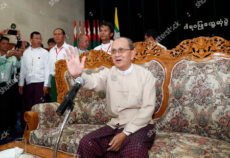 Myanmar former President Thein Sein waves at people during a gathering at the headquarters of Union Solidarity and Development Party (USDP), in Naypyitaw, Myanmar