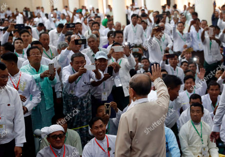 Stock Picture of Thein Sein, center, former President of Myanmar, greets to supporters during a gathering at the headquarters of Union Solidarity and Development Party (USDP), in Naypyitaw, Myanmar