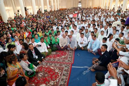 Stock Photo of Myanmar former President Thein Sein, center, sits among supporters during a gathering at the headquarters of Union Solidarity and Development Party (USDP), in Naypyitaw, Myanmar