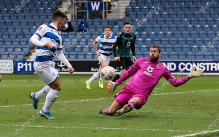 Ilias Chair of QPR triers to chip Goalkeeper Kristoffer Nordfeldt of Swansea City but the keeper saves