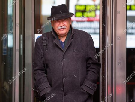BBC Deputy Political Editor, John Pienaar, leaves the BBC Studios.