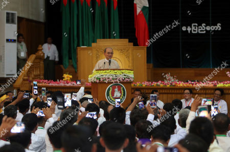 Stock Image of Supporters of Myanmar former President Thein Sein, take his photographs with their mobiles during a gathering at the headquarters of Union Solidarity and Development Party (USDP), in Naypyitaw, Myanmar