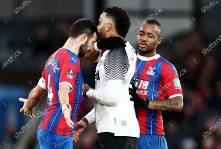 Stock Photo of Luka Milivojevic of Crystal Palace appears to head butt Tom Huddlestone of Derby County and is after shown a red card for violent conduct.