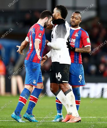 Luka Milivojevic of Crystal Palace appears to head butt Tom Huddlestone of Derby County and is after shown a red card for violent conduct.