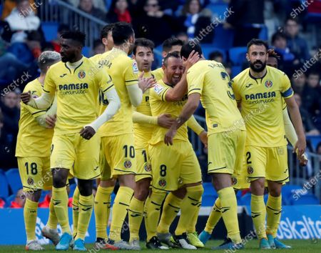 Villarreal's midfielder Santi Cazorla (C) celebrates with his teammates after scoring the 1-2 goal during the Spanish LaLiga match between Real Sociedad and Villarreal at Reale Arena stadium in San Sebastian, Basque Country, northern Spain, 05 January 2020.