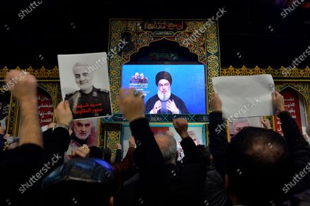 Supporters of Hezbollah listen to Hezbollah's Secretary-General Sayed Hassan Nasrallah as he delivers a speech on a screen during a mass rally to pay tribute the Iranian Revolutionary Guards Corps (IRGC) Lieutenant general and commander of the Quds Force Qasem Soleimani in the southern suburb of Beirut, Lebanon, 05 January 2020. The US Pentagon announced that Iran's Quds Force leader Soleimani and Iraqi militia commander Abu Mahdi al-Muhandis were killed on 03 January 2020 following a US airstrike at Baghdad's international airport. The attack comes amid escalating tensions between Tehran and Washington.