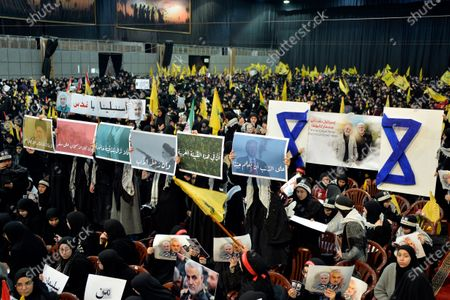 Stock Image of Supporters of Hezbollah carry placards and pictures of the Iranian Revolutionary Guards Corps (IRGC) Lieutenant general and commander of the Quds Force Qasem Soleimani as Hezbollah Secretary-General Sayed Hassan Nasrallah delivers a speech during a mass rally in the southern suburb of Beirut, Lebanon, 05 January 2020. The US Pentagon announced that Iran's Quds Force leader Soleimani and Iraqi militia commander Abu Mahdi al-Muhandis were killed on 03 January 2020 following a US airstrike at Baghdad's international airport. The attack comes amid escalating tensions between Tehran and Washington.