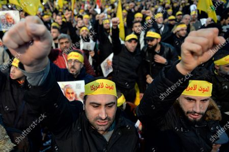 Supporters of Hezbollah carry Hezbollah flags and pictures of the Iranian Revolutionary Guards Corps (IRGC) Lieutenant general and commander of the Quds Force Qasem Soleimani as they shout slogans 'Death to America' as Hezbollah Secretary-General Sayed Hassan Nasrallah delivers a speech during a mass rally in the southern suburb of Beirut, Lebanon, 05 January 2020. The US Pentagon announced that Iran's Quds Force leader Soleimani and Iraqi militia commander Abu Mahdi al-Muhandis were killed on 03 January 2020 following a US airstrike at Baghdad's international airport. The attack comes amid escalating tensions between Tehran and Washington.
