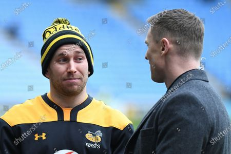 Wasps scrum half Dan Robson (9) chats to former England and Saints player Dylan Hartley during the Gallagher Premiership Rugby match between Wasps and Northampton Saints at the Ricoh Arena, Coventry