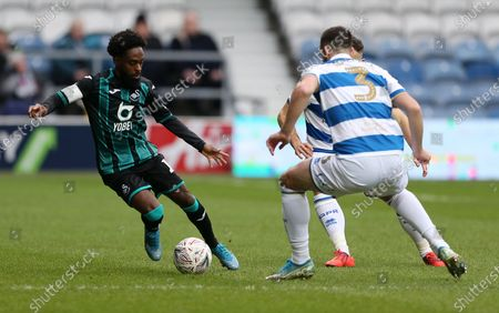 Nathan Dyer of Swansea City is challenged by Lee Wallace of QPR.