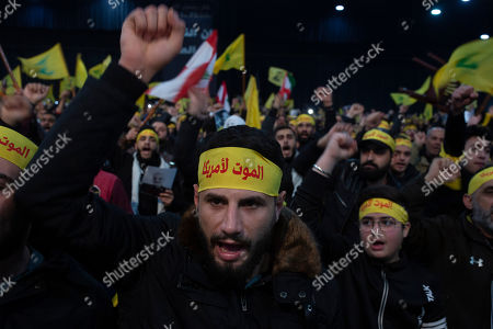 Supporters of Hezbollah leader Hassan Nasrallah chant slogans ahead of the leader's televised speech in a southern suburb of Beirut, Lebanon, following the U.S. airstrike in Iraq that killed Iranian Revolutionary Guard Gen. Qassem Soleimani. The headbands read: death to America