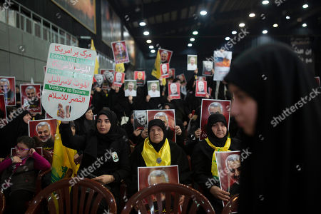 Women supporters of Hezbollah leader Sayyed Hassan Nasrallah gather ahead of the leader's televised speech in a southern suburb of Beirut, Lebanon, following the U.S. airstrike in Iraq that killed Iranian Revolutionary Guard Gen. Qassem Soleimani, seen in the placards they hold