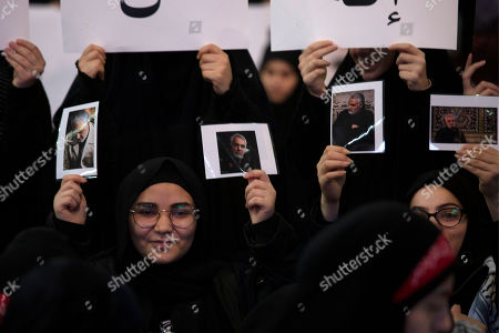 Women supporters of Hezbollah leader Sayyed Hassan Nasrallah hold portraits of slain Iranian Revolutionary Guard Gen. Qassem Soleimani before a televised speech by Nasrallah in a southern suburb of Beirut, Lebanon, following the U.S. airstrike in Iraq that killed Soleimani