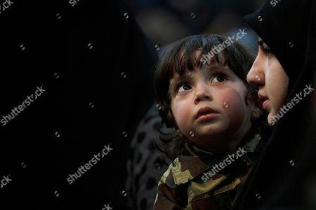 A child in tiny military fatigues attends a rally by supporters of Hezbollah leader Sayyed Hassan Nasrallah as they wait for his televised speech in a southern suburb of Beirut, Lebanon, following the U.S. airstrike in Iraq that killed Iranian Revolutionary Guard Gen. Qassem Soleimani