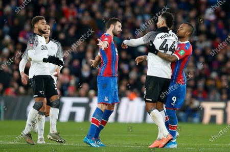 Luka Milivojevic (centre) of Crystal Palace after headbutting Tom Huddlestone of Derby County and is sent off