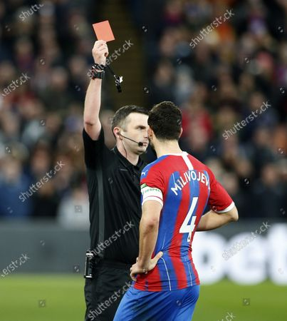 Luka Milivojevic of Crystal Palace is shown a red card by referee Michael Oliver after headbutting Tom Huddlestone of Derby County and is sent off