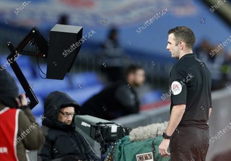 Referee Michael Oliver checks the VAR monitor by the side of the pitch before sending off Luka Milivojevic of Crystal Palace for headbutting Tom Huddlestone of Derby County