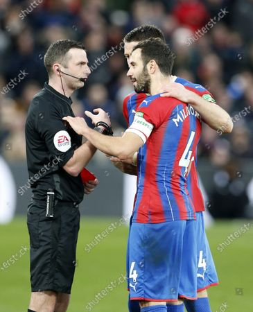 Luka Milivojevic of Crystal Palace with referee Michael Oliver after headbutting Tom Huddlestone of Derby County and is sent off