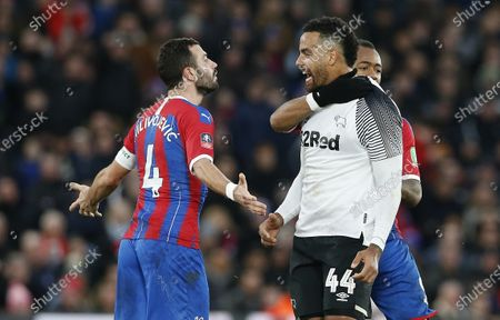 Luka Milivojevic of Crystal Palace confronts Tom Huddlestone of Derby County before headbutting him