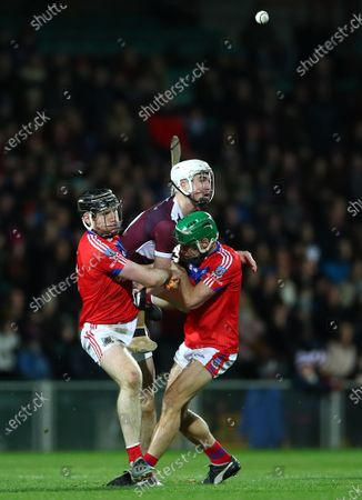 St. Thomas (Galway) vs Borris-Ileigh (Tipperary). St. Thomas' Shane Cooney and David Burke tackle Kieran Maher of Borris-Ileigh
