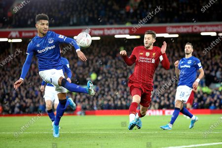 Everton defender Mason Holgate (2) clears with Liverpool midfielder Adam Lallana (20) closing in during the The FA Cup match between Liverpool and Everton at Anfield, Liverpool
