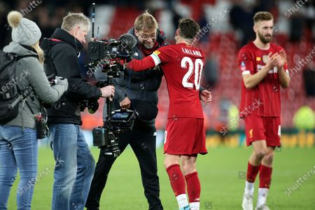 Liverpool Manager Jurgen Klopp doffs his cap to Liverpool midfielder Adam Lallana (20) then gives him the Klopp hug during the The FA Cup match between Liverpool and Everton at Anfield, Liverpool