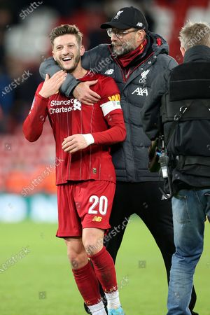 Liverpool midfielder Adam Lallana (20) gets a hug from Liverpool Manager Jurgen Klopp during the The FA Cup match between Liverpool and Everton at Anfield, Liverpool