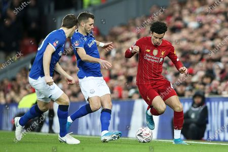 Stock Picture of Everton midfielder Morgan Schneiderlin (18) makes a tackle on Liverpool midfielder Curtis Jones (48) during the The FA Cup match between Liverpool and Everton at Anfield, Liverpool
