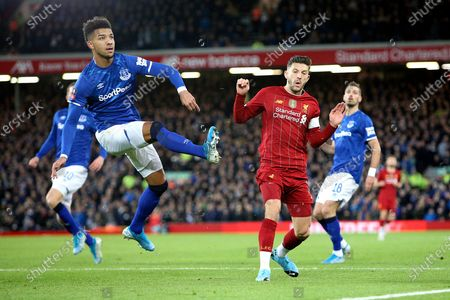 Everton defender Mason Holgate (2) clears with Liverpool midfielder Adam Lallana (20) closing in d during the The FA Cup match between Liverpool and Everton at Anfield, Liverpool